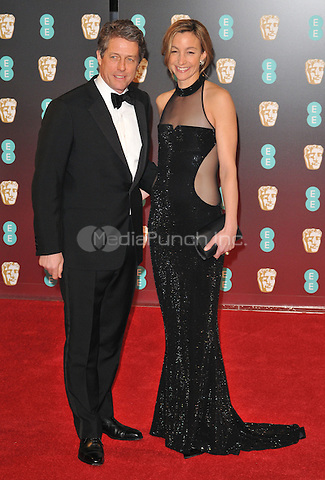 Hugh Grant and Anna Elisabet Eberstein at the EE British Academy Film Awards (BAFTAs) 2017, Royal Albert Hall, Kensington Gore, London, England, UK, on Sunday 12 February 2017.<br /> CAP/CAN<br /> &copy;CAN/Capital Pictures /MediaPunch ***NORTH AND SOUTH AMERICAS ONLY***