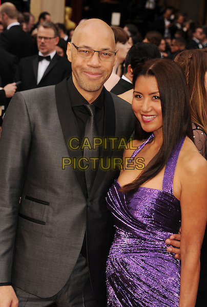 HOLLYWOOD, CA- MARCH 02: Screenwriter John Ridley (L) and wife Gayle Ridley attend the 86th Annual Academy Awards held at Hollywood &amp; Highland Center on March 2, 2014 in Hollywood, California.<br /> CAP/ROT/TM<br /> &copy;Tony Michaels/Roth Stock/Capital Pictures