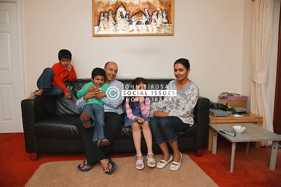 Asian family on sofa.