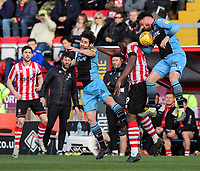 Lincoln City's John Akinde vies for possession with Stevenage's Michael Timlin, left, and Stevenage's Ron Henry<br /> <br /> Photographer Chris Vaughan/CameraSport<br /> <br /> The EFL Sky Bet League Two - Lincoln City v Stevenage - Saturday 16th February 2019 - Sincil Bank - Lincoln<br /> <br /> World Copyright © 2019 CameraSport. All rights reserved. 43 Linden Ave. Countesthorpe. Leicester. England. LE8 5PG - Tel: +44 (0) 116 277 4147 - admin@camerasport.com - www.camerasport.com