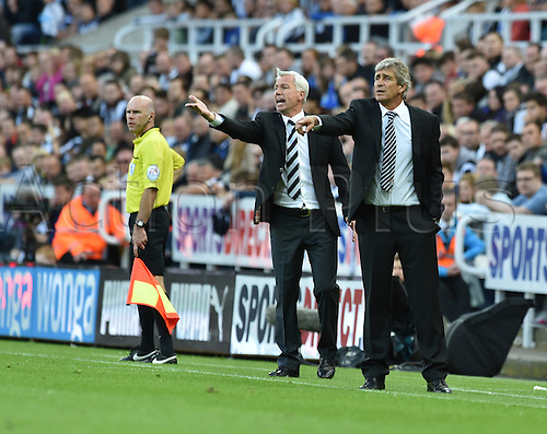 17.08.2014.  Newcastle upon Tyne, England. Premier League. Newcastle United versus Manchester City. Manchester City Manager Manuel Pellegrini and Newcastle manager Alan Pardew show their frustration from the touchline