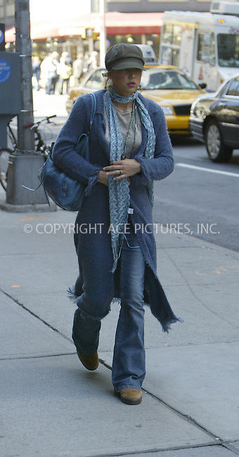 WWW.ACEPIXS.COM ** ** **EXCLUSIVE!!! FEE MUST BE NEGOTIATED BEFORE USE!!!....NEW YORK, APRIL 14, 2005....Anna Kournikova is seen entering her midtown hotel in what appears to be a periwinkle bathrobe, sneakers, a teal tank top and the must have Balenciaga bag. She takes a moment to pose for pictures with autograph hounds. She then enters the hotel and adds a pair of jeans, a hat and sunglasses to the outfit but still retains what looks to be a fuzzy bathrobe with fringe. She then heads to Park Avenue for a walk where she digs around in her Balenciaga bag for  her cell phone.....Please byline: IAN WINGFIELD - ACE PICTURES.. *** ***  ..Ace Pictures, Inc:  ..Craig Ashby (212) 243-8787..e-mail: picturedesk@acepixs.com..web: http://www.acepixs.com