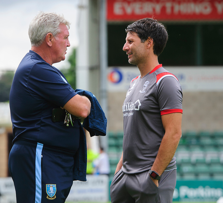 Sheffield Wednesday's manager Steve Bruce, left, and Lincoln City manager Danny Cowley prior to the game<br /> <br /> Photographer Chris Vaughan/CameraSport<br /> <br /> Football Pre-Season Friendly - Lincoln City v Sheffield Wednesday - Saturday July 13th 2019 - Sincil Bank - Lincoln<br /> <br /> World Copyright © 2019 CameraSport. All rights reserved. 43 Linden Ave. Countesthorpe. Leicester. England. LE8 5PG - Tel: +44 (0) 116 277 4147 - admin@camerasport.com - www.camerasport.com