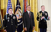 United States President Barack Obama, center, listens as the citation is read prior to awarding Kyle J. White, a former active duty U.S. Army Sergeant, left, the Medal of Honor for conspicuous gallantry in the East Room of the White House, May 13, 2014 in Washington, DC. <br /> Credit: Olivier Douliery / Pool via CNP