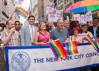 New York City Council Speaker Melissa Mark-Viverito, in red, with other NY City Councilmembers in the annual Lesbian, Gay, Bisexual and Transgender Pride Parade on Fifth Avenue in New York on Sunday, June 28, 2015. (© Richard B. Levine)