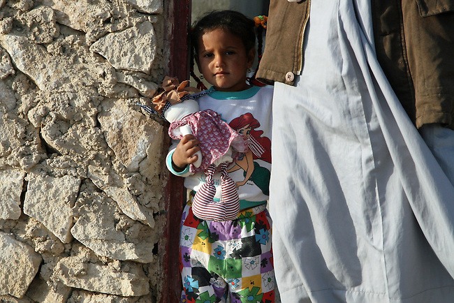 A young girl holds a doll given to her by Iraqi soldiers as they searched the village of Al Cheb Allib, Iraq for insurgents and weapons. The soldiers found nothing, and the villagers generally welcomed their presence. Nov. 29, 2007. DREW BROWN/STARS AND STRIPES