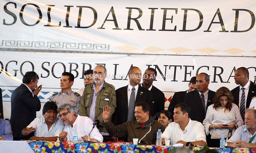 Venezuelan President Hugo Chavez (2R) gestures, flanked by his counterpart from Ecuador Rafael Correa(R), Paraguay's President Fernando Lugo(C) and Bolivia's Evo Morales(2L) during a meeting with peasants in Belem do Para, northern Brazil, on January 29, 2009 in the framework of the World Social Forum.