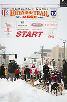 Zoya DeNure leaves the 2011 Iditarod ceremonial start line in downtown Anchorage, during the 2012 Iditarod..Jim R. Kohl/Iditarodphotos.com