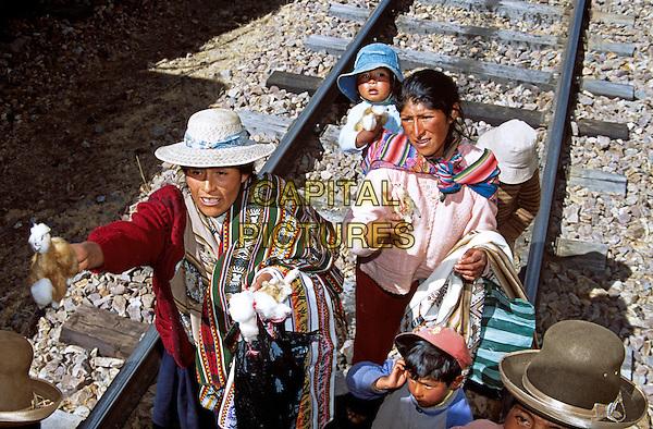 Women selling gifts on railway track, near La Raya, Puno to Cusco Perurail train journey, Peru