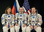 Star City, Russia - August 30, 2006 -- Attired in Russian Sokol launch and entry suits, astronaut Michael E. Lopez-Alegria (right), Expedition 14 commander and National Aeronautics and Space Administration (NASA) space station science officer; cosmonaut Mikhail Tyurin, flight engineer representing Russia's Federal Space Agency; and spaceflight participant Anousheh Ansari, 39, the first female space tourist,  take a break from training in Star City, Russia to pose for a portrait on November 8, 2005. The mission is scheduled to launch September 14, 2006..Credit: Gagarin Cosmonaut Training Center via CNP