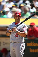 OAKLAND, CA - AUGUST 8:  Kendrys Morales of the Los Angeles Angels bats during the game against the Oakland Athletics at O.co Coliseum on Wednesday, August 8, 2012 in Oakland, California. Photo by Brad Mangin