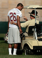 TALLAHASSEE, FL. 8/8/09-FSU-BOWDEN 0808 CH01-Florida State Coach Bobby Bowden gives advice to A.J. Alexander during practice Saturday in Tallahassee...COLIN HACKLEY PHOTO