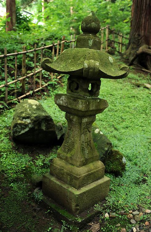 Stone lantern in a garden in Iwaki Shrine.