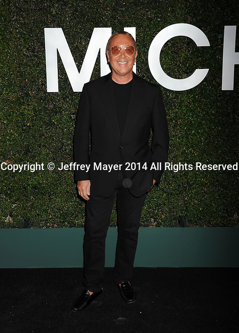BEVERLY HILLS, CA- OCTOBER 02: Designer Michael Kors arrives at the Michael Kors Hosts Launch Of Claiborne Swanson Frank's 'Young Hollywood' Portrait Book at a private residence on October 2, 2014 in Beverly Hills, California.