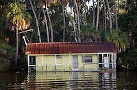 CHASSAHOWITZKA, FLORIDA, USA - JULY 1, 2007: A fish camp sinks into the he rural Chassahowitzka River before  it flows into the Gulf of Mexico in Citrus County, Florida. Photo by Matt May