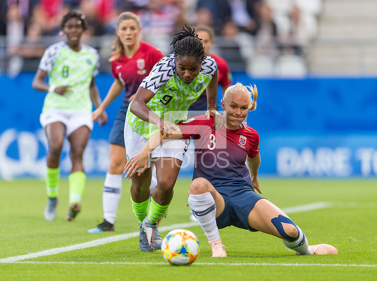 REIMS, FRANCE - JUNE 8: Desire Oparanozie #9 of Nigeria has the ball shielded from her by Maria Thorisdottir #3 of Norway during a 2019 FIFA Women's World Cup match between Norway and Nigeria at Stade Auguste-Delaune on June 8, 2019 in Reims, France.