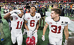 Alabama Crimson Tide wide receiver Henry Ruggs III (11), Alabama Crimson Tide wide receiver DeVonta Smith (6) and Alabama Crimson Tide defensive back Keaton Anderson (31) celebrate their 26-23 victory over the Georgia Bulldogs in the NCAA College Football Playoff National Championship at Mercedes-Benz Stadium on January 8, 2018 in Atlanta. Photo by Mark Wallheiser/UPI