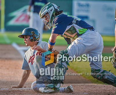 1 September 2014: Vermont Lake Monsters catcher Jose Chavez gets infielder Mott Hyde out at the plate in the 7th inning against the Tri-City ValleyCats at Centennial Field in Burlington, Vermont. The ValleyCats defeated the Lake Monsters 3-2 in NY Penn League action. Mandatory Credit: Ed Wolfstein Photo *** RAW Image File Available ****