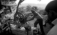 11.2003 Orissa<br /> <br /> Man making and selling sugar cane juice.<br /> <br /> Homme faisant un jus de canne a sucre.