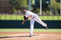 Glendale Desert Dogs starting pitcher Chris Lee (63), of the Baltimore Orioles organization, follows through on his delivery during an Arizona Fall League game against the Mesa Solar Sox at Camelback Ranch on November 12, 2018 in Glendale, Arizona. Glendale defeated Mesa 4-2. (Zachary Lucy/Four Seam Images)