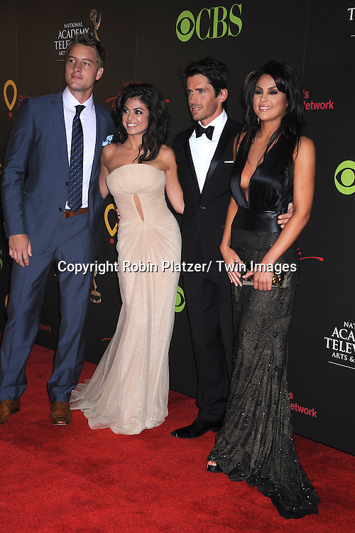 Justin Hartley, Lindsay Hartley, Brandon Beemer and Nadia Bjorlin  arriving at the 38th Annual Daytime Emmy Awards  on June 19, 2011 at The Las Vegas Hilton in Las Vegas Nevada. ..