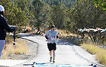 Half marathon runner Erick Studenicka crosses the finish line in the 8th annual Take it to the Lake race at Cave Lake State Park, near Ely, Nev., on Saturday, Sept. 21, 2019.<br /> Photo by Cathleen Allison/Nevada Momentum
