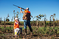 "Josh Wildin (cq) with his 6 year old daughter Makenzie Wildin on opening day of the dove hunting season on Kansas State Wildlife fields near Wamego, Kansas, Sunday, September 1, 2013. Opening day is known for being a festive day of hunting with family and friends. ""It's been really important to bring her out with me. Her favorite part is my favorite part...eating the little buggers. Just because she's a girl, I don't want her to miss out on this,"" says  Wildin.<br /> <br /> Photo by Matt Nager"