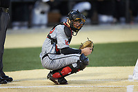 Louisville Cardinals catcher Ben Metzinger (22) looks to the dugout for the sign during the game against the Wake Forest Demon Deacons at David F. Couch Ballpark on March 7, 2020 in  Winston-Salem, North Carolina. The Demon Deacons defeated the Cardinals 3-2. (Brian Westerholt/Four Seam Images)