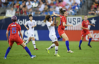 CHARLOTTE, NC - OCTOBER 03: Andi Sullivan #25 of the United States surrounded by Korean Republic players passes off a ball during a game between the USA and Korea Republic at Bank of American Stadium, on October 03, 2019 in Charlotte, NC.