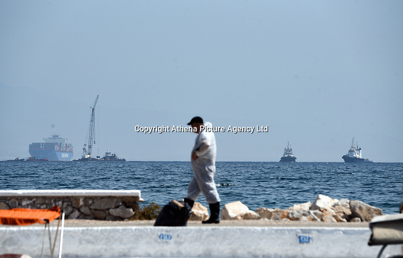 "Pictured: Specialist crew work to contain the oil spill that has reached the coast of Salamina, Greece<br /> Re: An oil spill off Salamina island's eastern coast is spreading and has become ""an environmental disaster"" according to local authorities in Greece.<br /> The spill was caused by the sinking of the Aghia Zoni II tanker, carrying 2,200 metric tons of fuel oil and 370 metric tons of marine gas oil on Saturday, southwest of the islet of Atalanti near Psytalleia. According to reports, the coastline stretching from Kinosoura to the Selinia community has ""turned black"" and authorities fear a new leak from the sunken ship.<br /> According to the island's mayor, Isidora Papathanasiou, the weather ""turned on Sunday afternoon and brought the oil spill to Salamina."""
