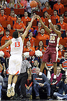 Florida State guard Ian Miller (30) shoots over Virginia forward Anthony Gill (13) during the second half of an NCAA basketball game Saturday Jan. 18, 2014 in Charlottesville, VA. Virginia defeated Florida State 78-66. (AP Photo/Andrew Shurtleff)