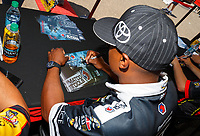 Jun 9, 2017; Englishtown , NJ, USA; NHRA top fuel driver Antron Brown signs autographs during qualifying for the Summernationals at Old Bridge Township Raceway Park. Mandatory Credit: Mark J. Rebilas-USA TODAY Sports