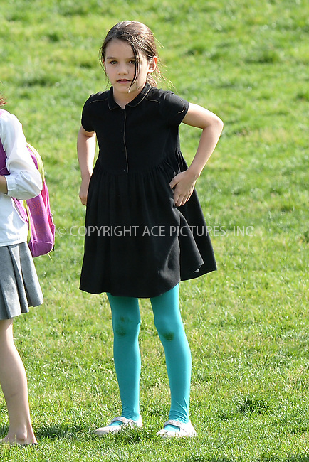WWW.ACEPIXS.COM<br /> May 30, 2014 New York City<br /> <br /> Katie Holmes and Suri Cruise play in the park in New York City on May 30, 2014.<br /> <br /> By Line: Kristin Callahan/ACE Pictures<br /> ACE Pictures, Inc.<br /> tel: 646 769 0430<br /> Email: info@acepixs.com<br /> www.acepixs.com