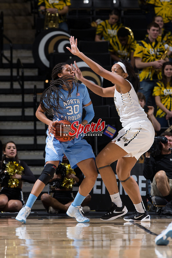 Hillary Summers (30) of the North Carolina Tar Heels is guarded by Kandice Ball (42) of the Wake Forest Demon Deacons during second half action at the LJVM Coliseum on January 21, 2016 in Winston-Salem, North Carolina.  The Demon Deacons defeated the Tar Heels 75-63.  (Brian Westerholt/Sports On Film)