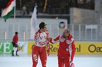 SCHAATSEN: BOEDAPEST: Essent ISU European Championships, 08-01-2012, 10000m Men, Denis Yuskov RUS, coach Kosta Poltavets, ©foto Martin de Jong