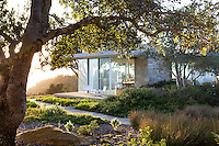 Modern glass home on hill with California native plant garden, Santa Barbara,