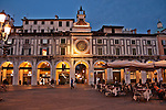 Piazza della Loggia at night, with the 16th century clock tower with two figures on the top that strike the bell in Brescia, Italy