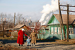 """Photo by Heathcliff Omalley..Nizhny Tagil 9 November 2007.(left) 55 yr old Lyndmilla Krasikova who gave up her job due to throat cancer walks with her grandson """"Lyosha"""" and neighbour Valentina in the Industrial town of Nizhny Tagil 150km from Yekaterinburg in the Urals.The city has one of the highest rates of pollution the country."""