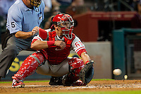Philadelphia Phillies catcher Carlos Ruiz #51 on defense during the Major League baseball game against the Houston Astros on September 16th, 2012 at Minute Maid Park in Houston, Texas. The Astros defeated the Phillies 7-6. (Andrew Woolley/Four Seam Images).