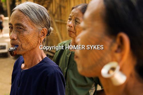 PANMYAUNG VILLAGE,  Myanmar (Burma) 2008. Three Chin tribal women with tattooed faces.