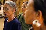 PANMYAUNG VILLAGE,  Myanmar (Burma) 2008. Three Chin tribal women with tattooed faces.
