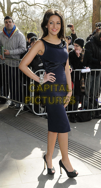 Michelle Keegan.The TRIC Awards 2013 (Television and Radio Industries Club Awards) held at the Grosvenor House Hotel - Arrivals..Grovsnor Hotel, London, England..March 12th, 2013.full length blue sleeveless dress hand on hip silver bracelet .CAP/CAN.©Can Nguyen/Capital Pictures.