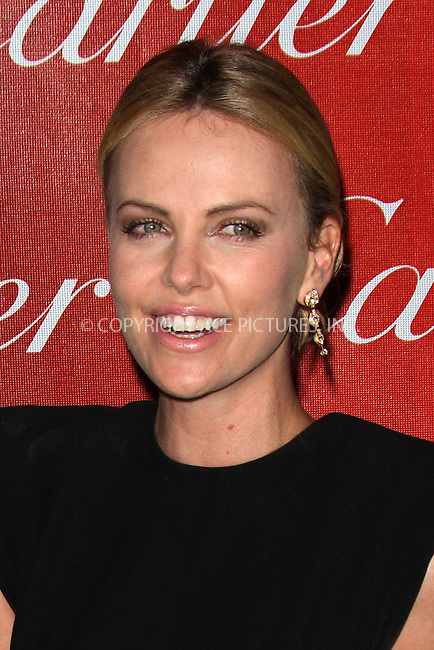 WWW.ACEPIXS.COM . . . . .  ..... . . . . US SALES ONLY . . . . .....January 7 2012, LA....Charlize Theron at the 23rd Palm Springs International Film Festival Gala held at the PS Convention Center on January 7 2012 in California....Please byline: FAMOUS-ACE PICTURES... . . . .  ....Ace Pictures, Inc:  ..Tel: (212) 243-8787..e-mail: info@acepixs.com..web: http://www.acepixs.com