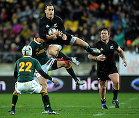 Israel Dagg beats Ruan Pienaar to a high ball. Investec Tri-Nations - All Blacks v South Africa at Westpac Stadium, Wellington on Saturday 17 July 2010. Photo: Dave Lintott/lintottphoto.co.nz