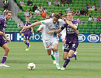 Josh Kennedy fight for the ball with Michael Thwaite   during the  A-League soccer match between Melbourne City FC and Perth Glory at AAMI Park on February 22, 2015 in Melbourne, Australia.