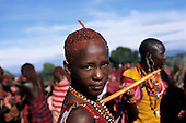 Lolgorian, Kenya. Siria Maasai Manyatta; portrait of a young moran, red ochre coloured short hair, bead decorations.