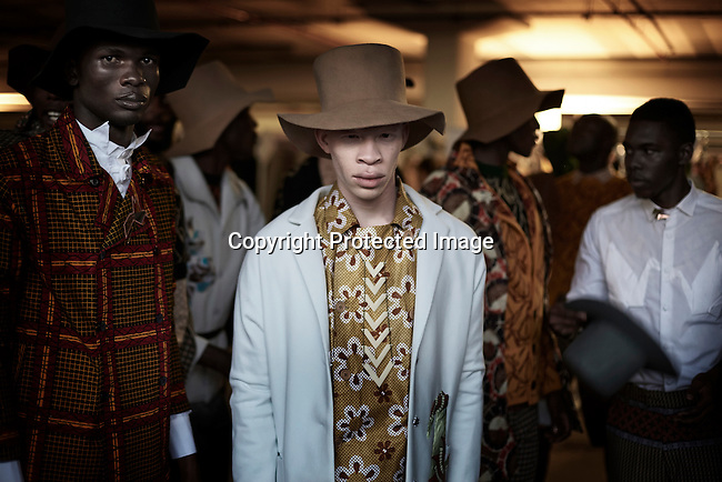 CAPE TOWN, SOUTH AFRICA &ndash; FEBRUARY 7: South African model Sanele Junior Xaba stands backstage before a show with the South African designer Chu Suwanapha during the South African Menswear Week in the Cape Town Stadium, South Africa 2015 <br /> (Photo by: Per-Anders Pettersson)