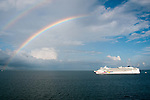 As a local rain squall passed, we were impressed to see a rainbow appear directly over a nearby cruise ship, the Norwegian Jewel.  At the anchorage off Belize.