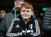 2nd December 2017, Griffen Park, Brentford, London; EFL Championship football, Brentford versus Fulham; Young Fulham fan looks on from the away stand