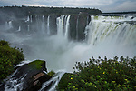 Mist obscures the Iguazu River below the Garganta del Diablo or the Devil's Throat Waterfall in Iguazu Falls National Park in both Argentina and Brazil.  Both parks are UNESCO World Heritage Sites.  The foreground is in Argentina with Brazil across the river .